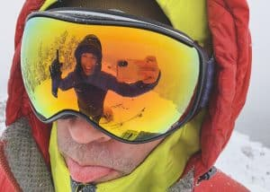 a photo of my reflection in the snow goggles mike is wearing